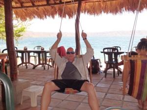 Steve kicks back in a hammock swing on the shores of the Apoyo Lagoon